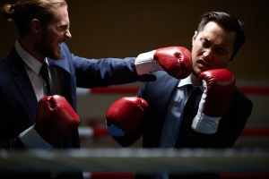 Gloating businessman fighting with rival